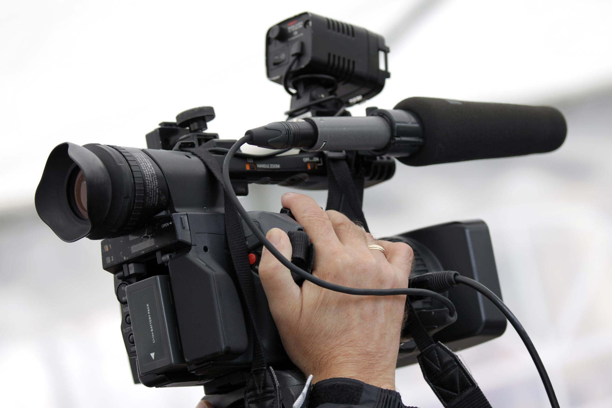 man holding the video camera