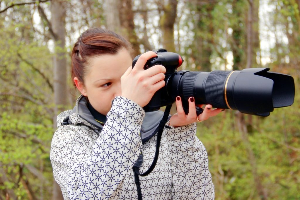 lady holding the camera