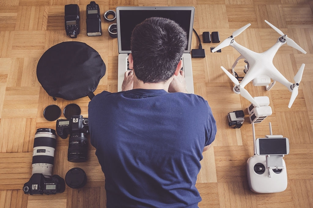 Photographer with lots of equipment planning his next shoot