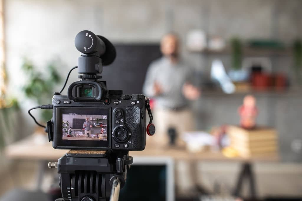 man filming video for commercial advertisement